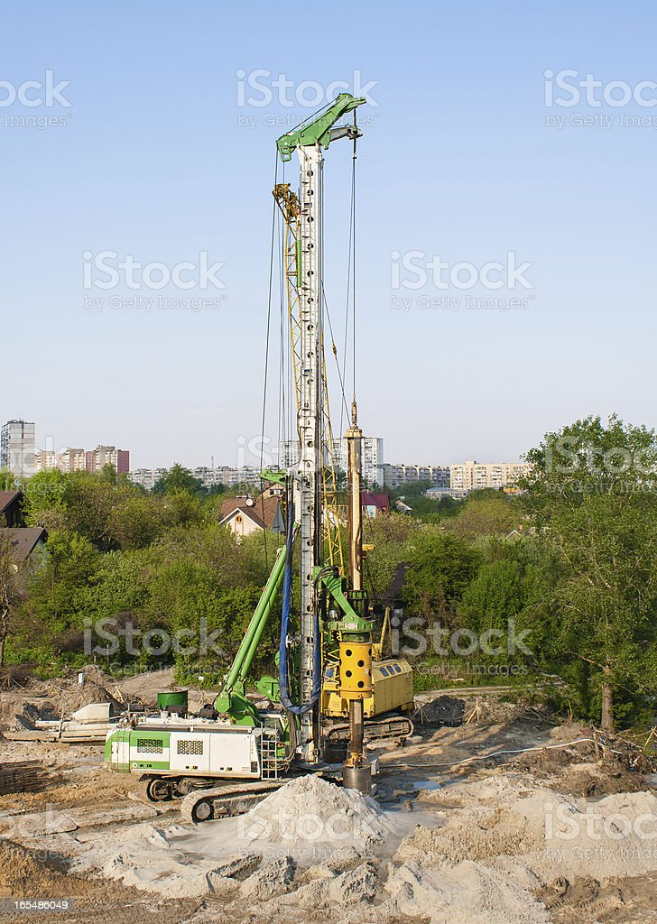 Pile driver at a construction site royalty-free stock photo
