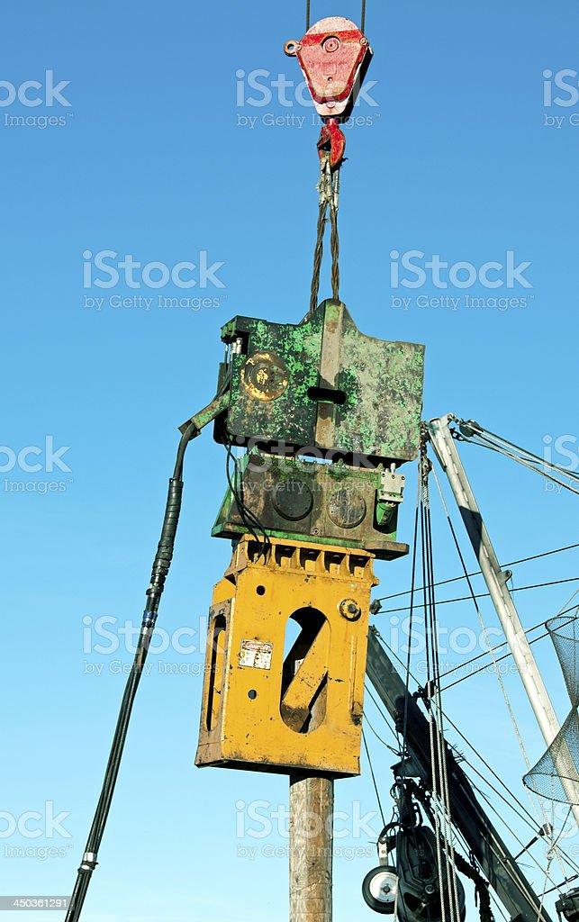 Pile driver on crane royalty-free stock photo