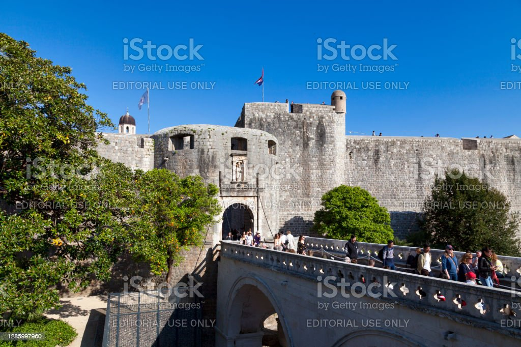 Pile Gates in Dubrovnik Dubrovnik, Croatia - April 19 2019: The Pile Gates are a well-fortified complex with multiple doors, defended by Fort Bokar and the moat that ran around the outside section of the city walls. Architecture Stock Photo