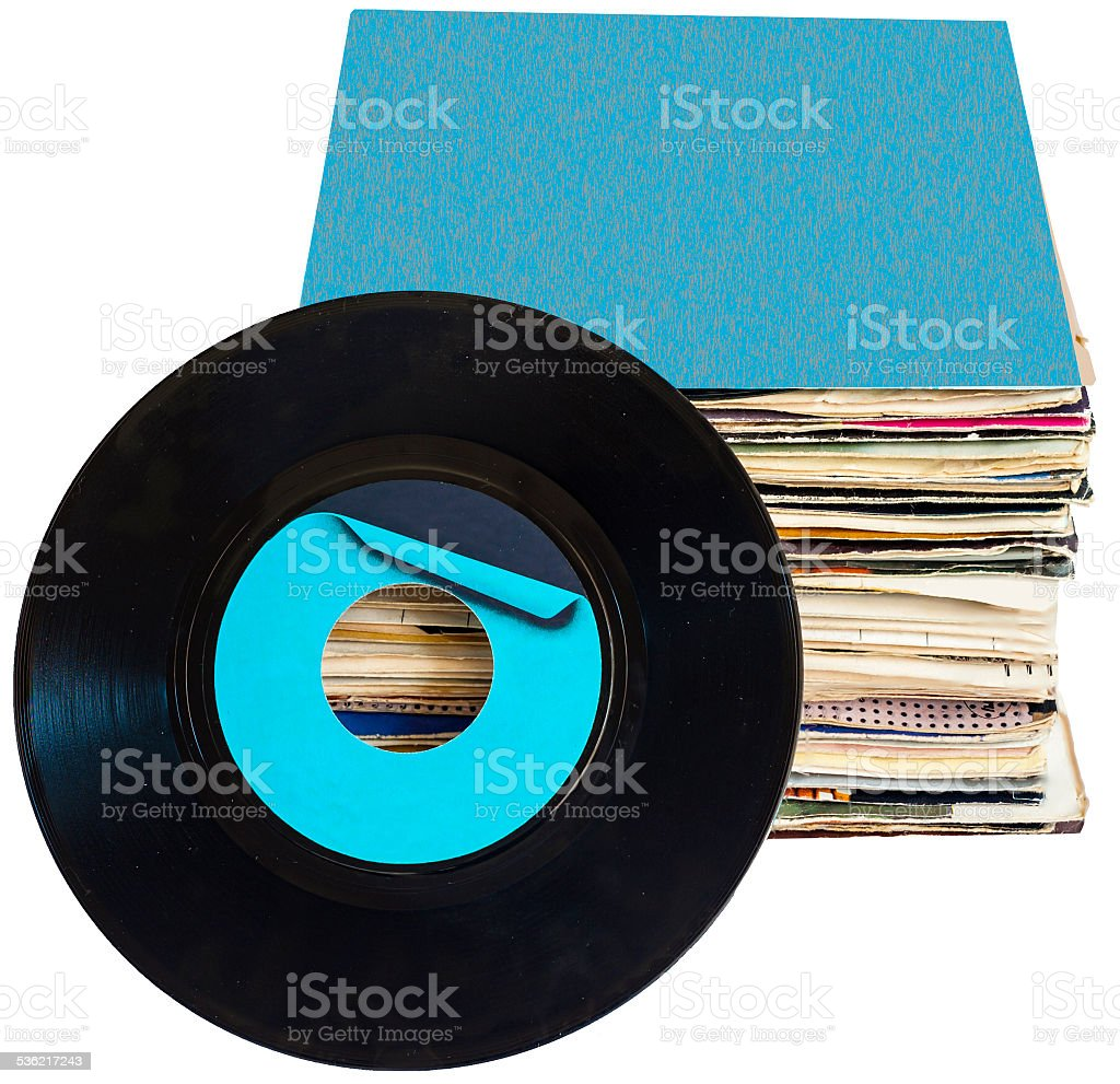 Pile of 45 RPM vinyl records used and dirty stock photo