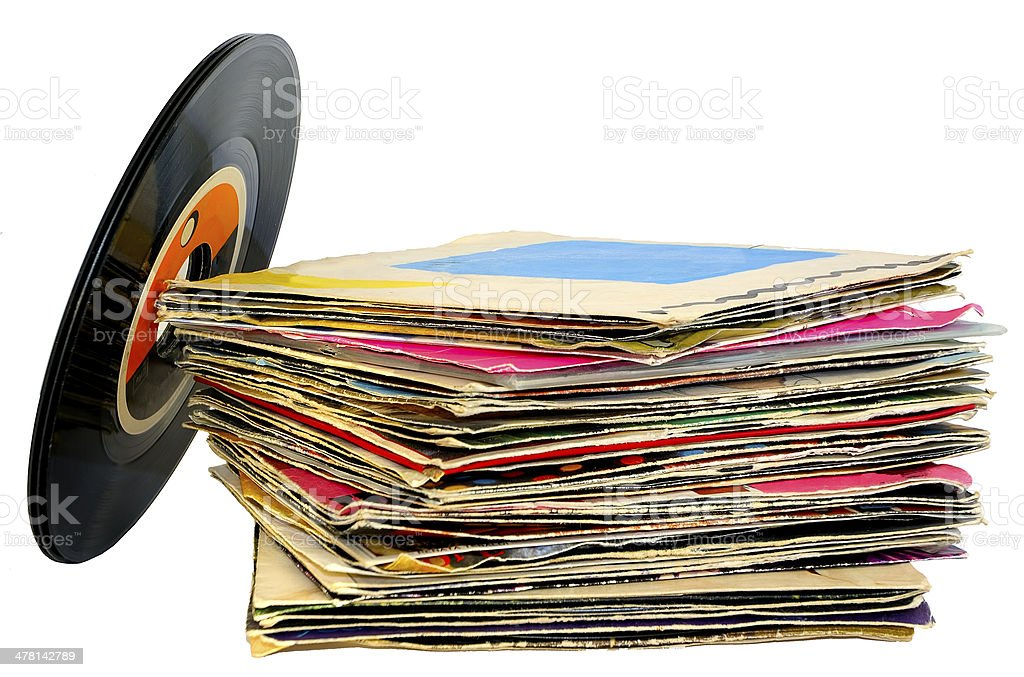 pile of 45 RPM vinyl records used A pile of 45 RPM vinyl records used and dirty even if in good condition Record - Analog Audio Stock Photo
