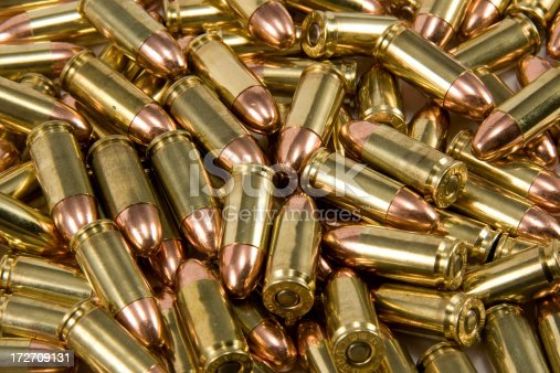 Pile of 9mm bullets laying in a pile