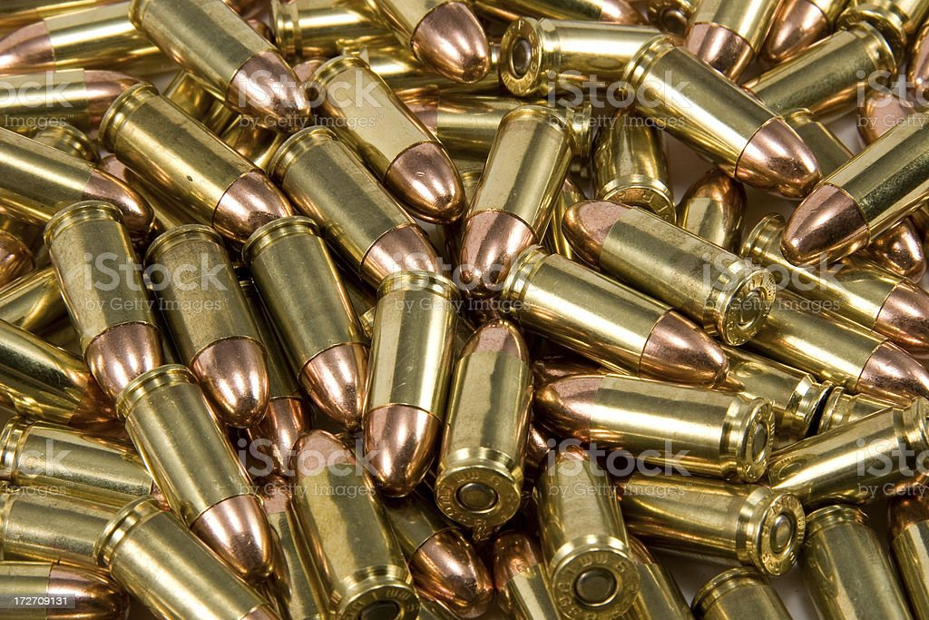 Pile of 9mm bullet ammunition stock photo