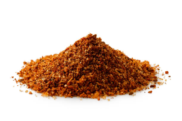 a pile of a red bbq spice mix ioslated on white. - seasoning stock photos and pictures