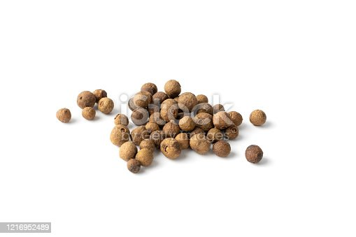 Pile of allspice isolated on white background top view. Jamaica pepper, allspice peppercorns or myrtle pepper close up