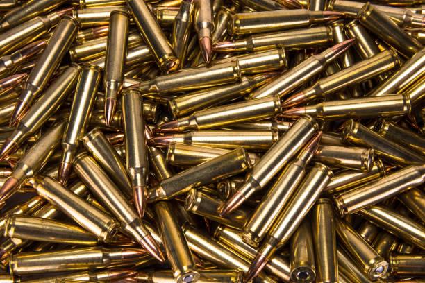 pile of ammo - proiettile foto e immagini stock