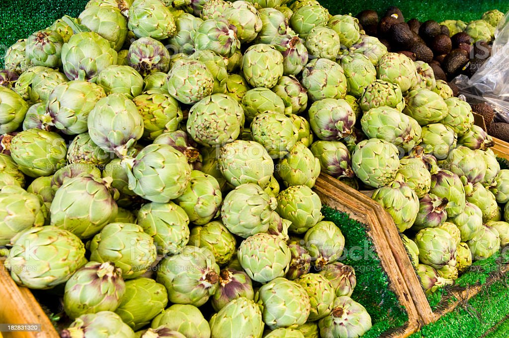 Pile of Artichokes at a farmers market stock photo