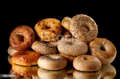 Assorted bagels stacked.