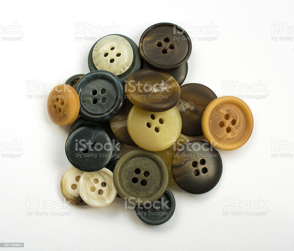 Pile of Assorted Dark Buttons Isolated on White stock photo