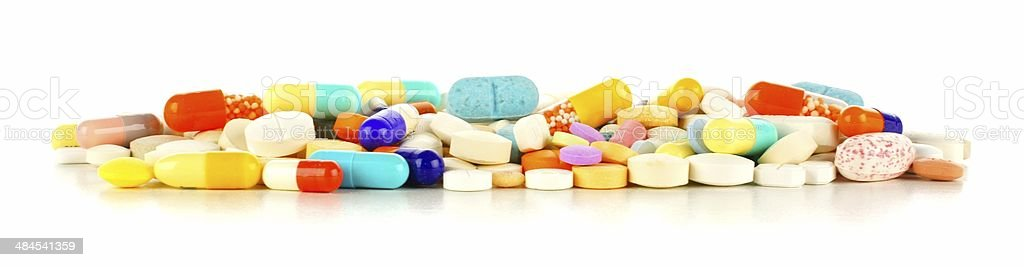 Pile of assorted medication forming a border over white stock photo