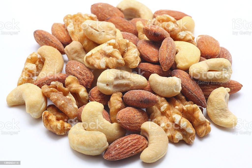 Pile of assorted mixed nuts on white background stock photo