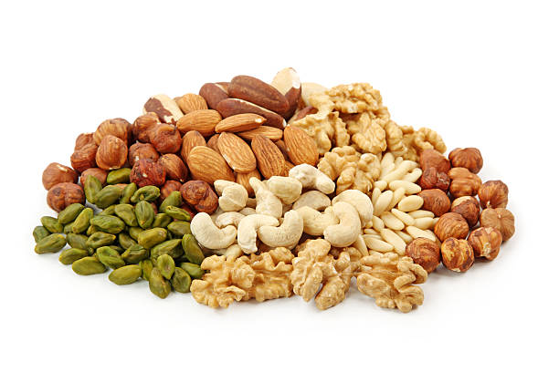 pile of assorted nuts on white background - 硬殼果 個照片及圖片檔