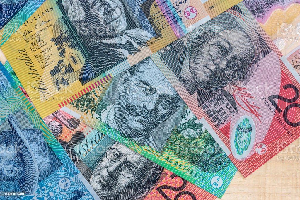 Pile of australian dollars on wooden desk stock photo