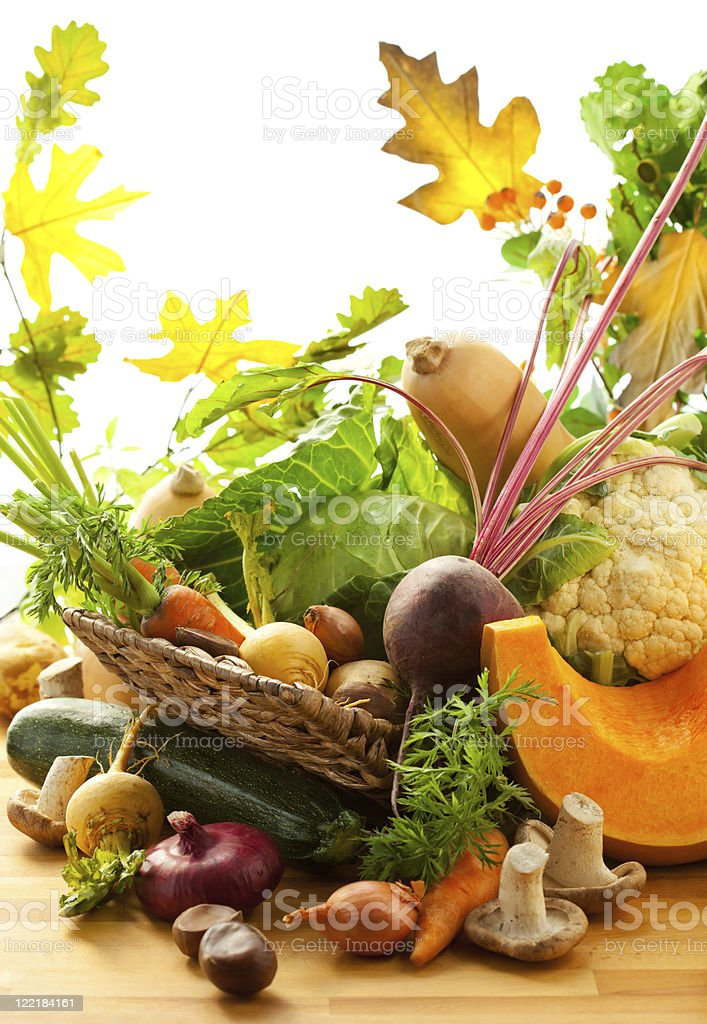 Pile of autumn leaves and vegetables royalty-free stock photo
