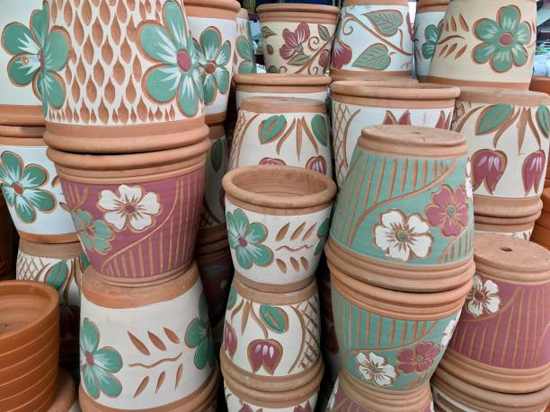 Pile of baked clay pot selling in gardening store stock photo