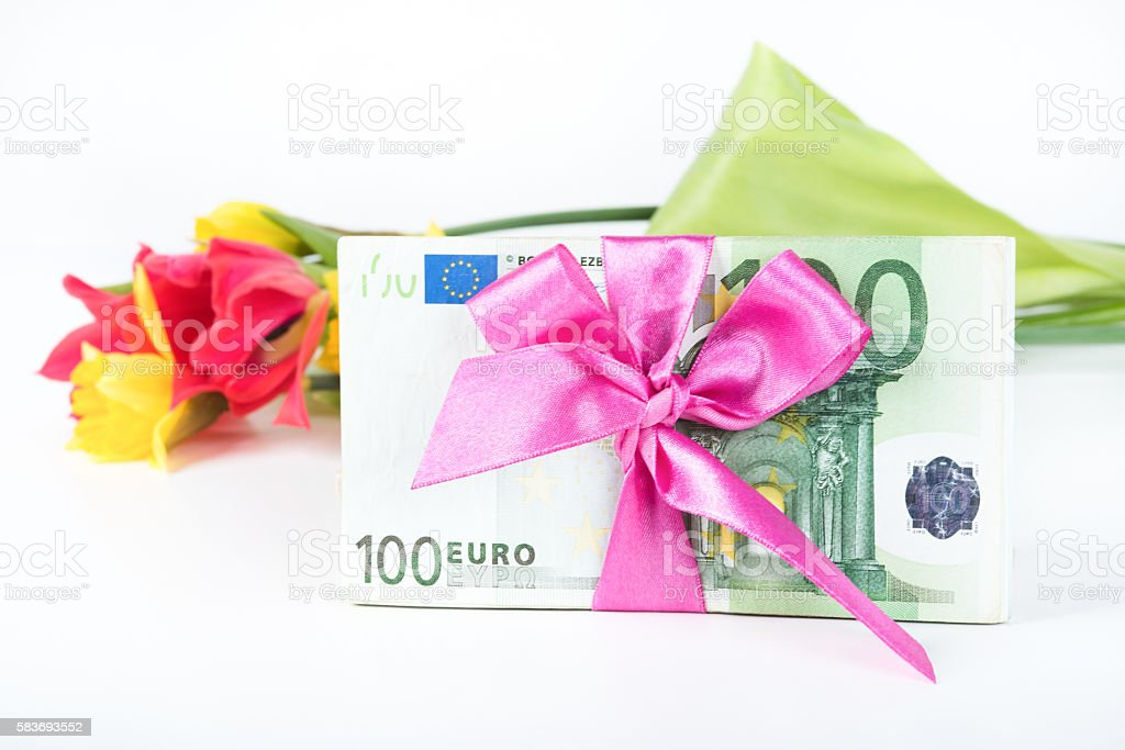Pile of banknotes related ribbon on gift. stock photo