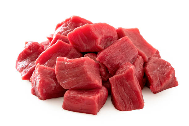 Pile of beef cubes isolated on white. Pile of beef cubes isolated on white. beef stock pictures, royalty-free photos & images