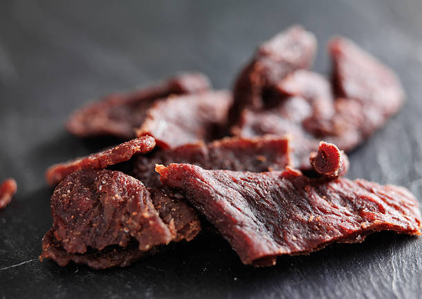 pile of beef jerky shot with selective focus - beef stock pictures, royalty-free photos & images