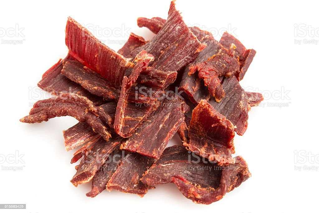 Pile of beef jerky with a white background stock photo