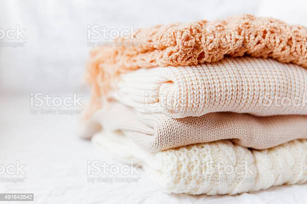 Pile of beige woolen clothes on a white background picture id491643542?b=1&k=6&m=491643542&s=612x612&h=yqp50zfrvalf svvx0hqgpbe59ibnbkjrkw2t557c 8=