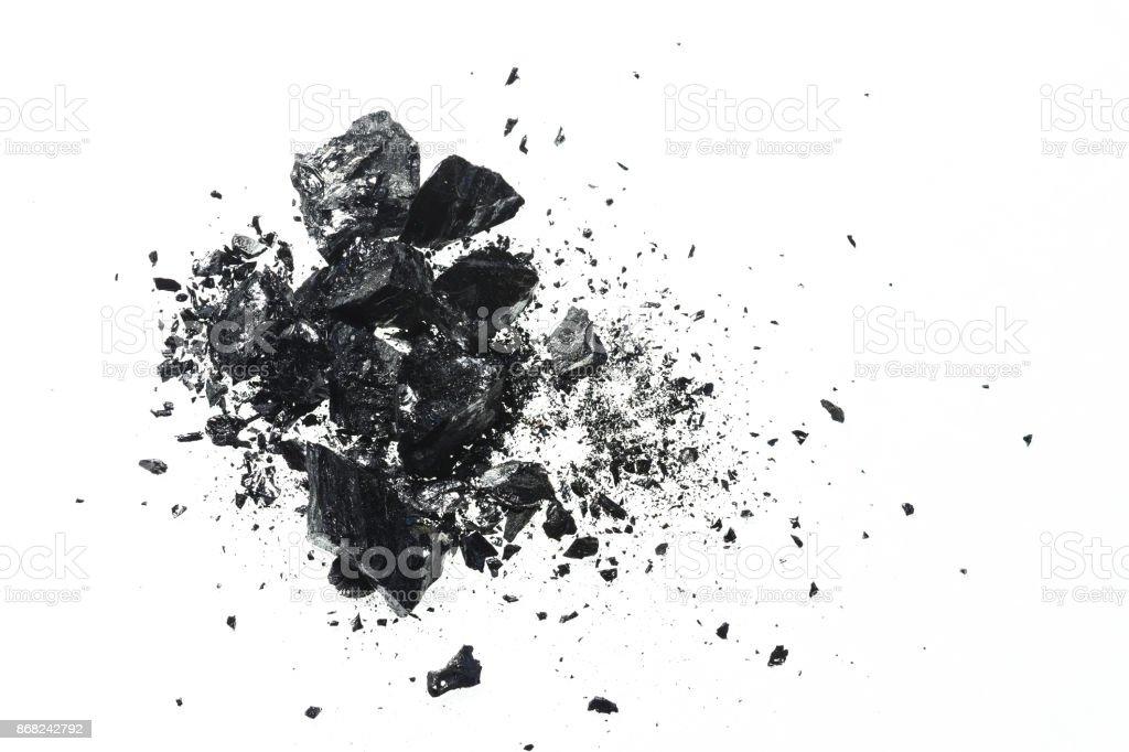 Pile of black coal bars isolated on white background stock photo