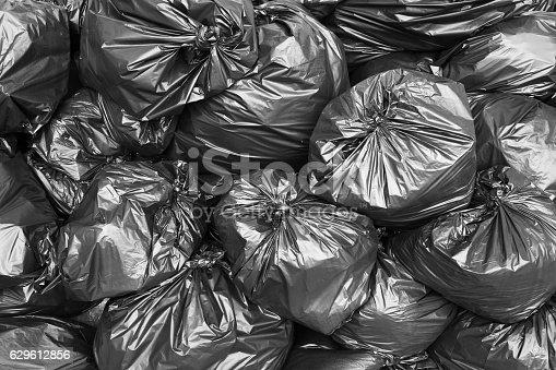 A pile of black garbage bags.