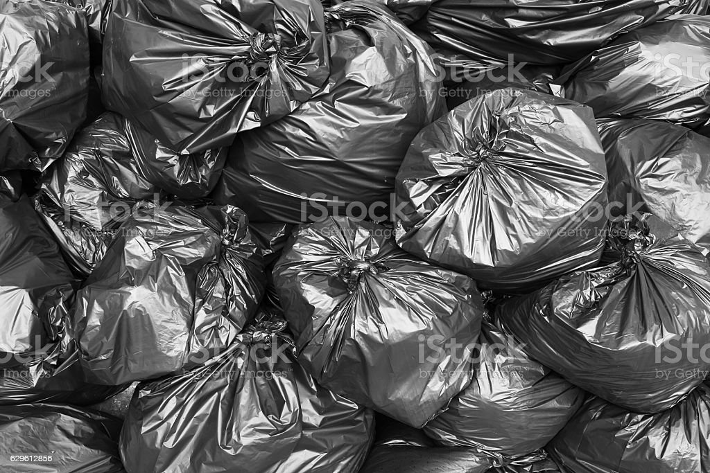 A pile of black garbage bags. stock photo