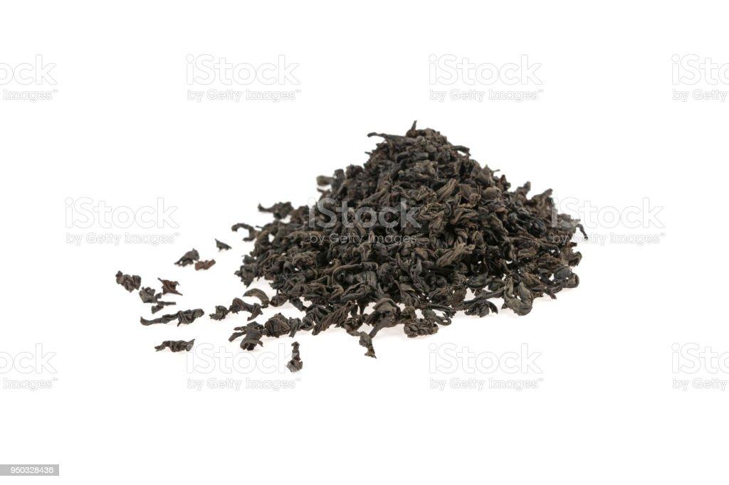 pile of black large-leafed tea on white background stock photo
