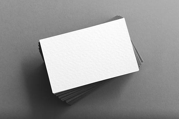 pile of blank business cards on table - business card stock photos and pictures
