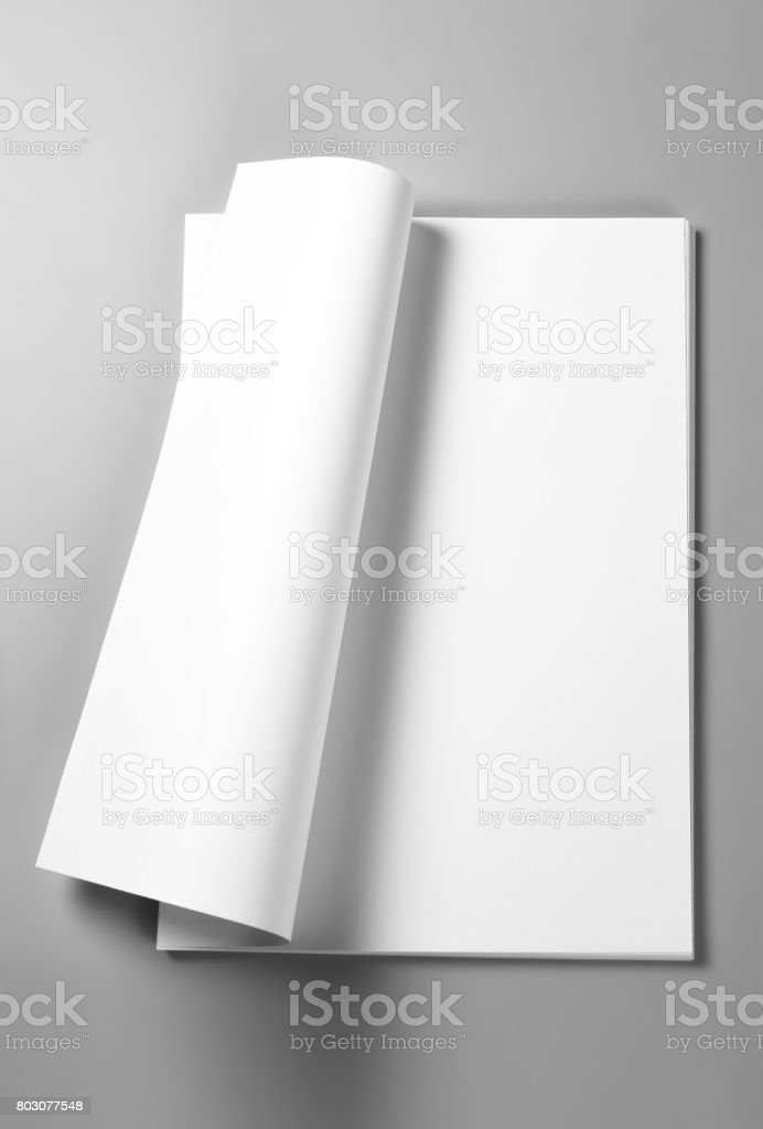 Pile of blank sheets of paper with curled upper page stock photo
