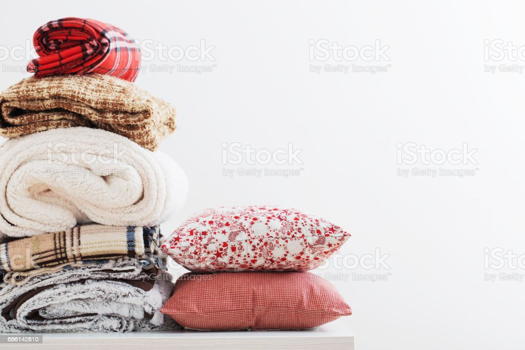 pile of blankets on a white background stock photo