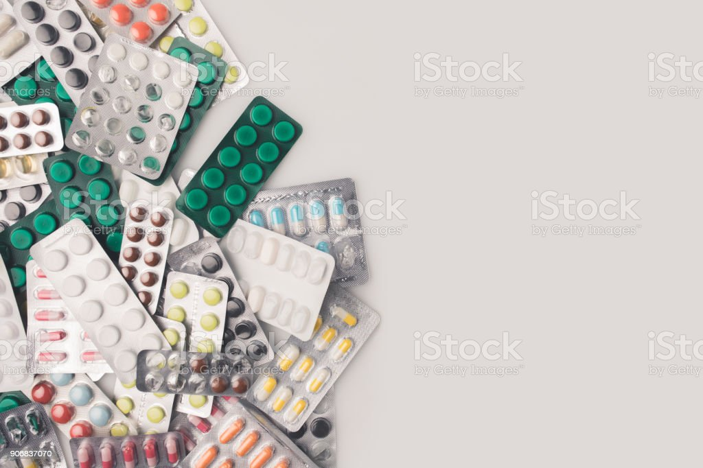 pile of blister packs with pills stock photo