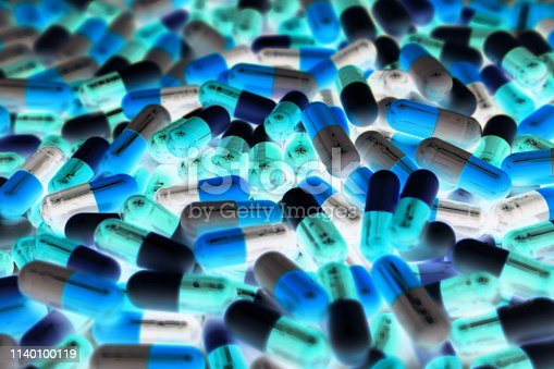 istock Pile of blue, green, and white color of capsule pills with modern design light. Toxicology medicine concept. QC and QA in pharmaceutical industry background. Global healthcare. 1140100119