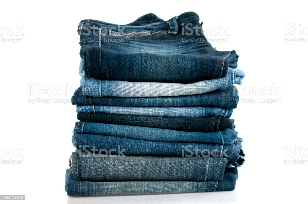 Pile of blue jeans stacked high stock photo