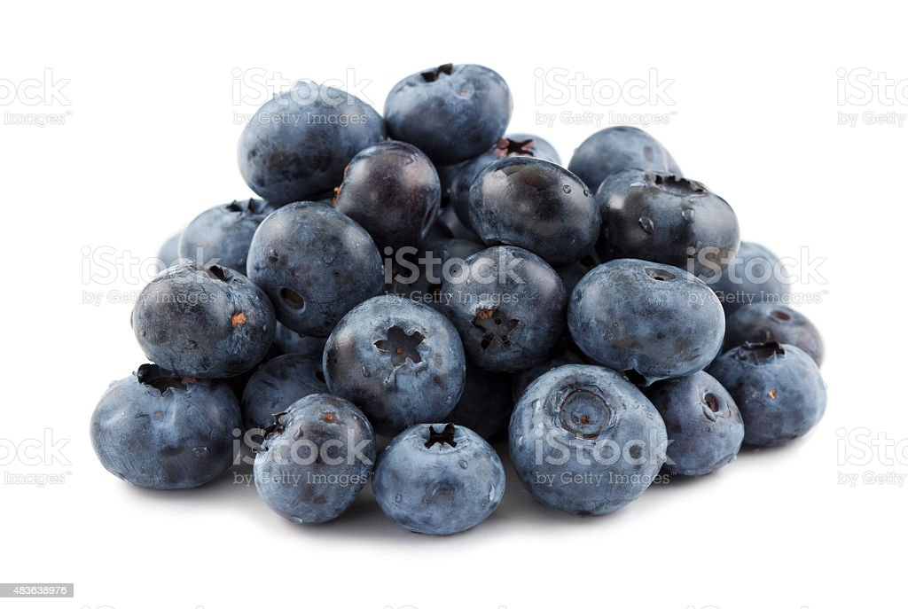 Pile of blueberries against a white background stock photo