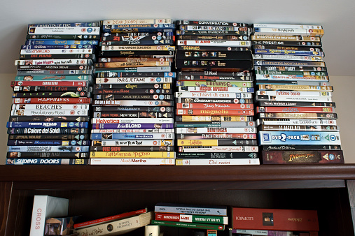 Pile of books and DVDs