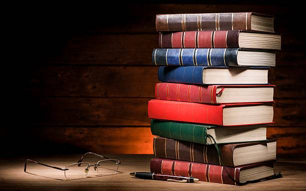 pile of books and glasses stock photo