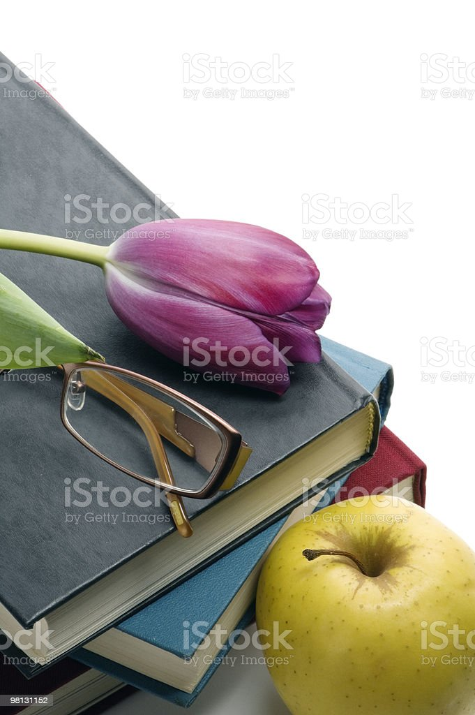 Pile of books, glasses and Tulip royalty-free stock photo