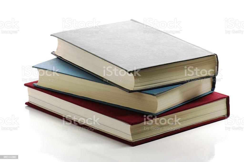 Pila di libri isolato su sfondo bianco foto stock royalty-free