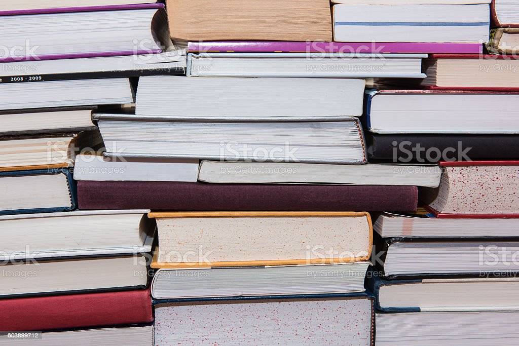 Pile of books stacked on top of each other stock photo