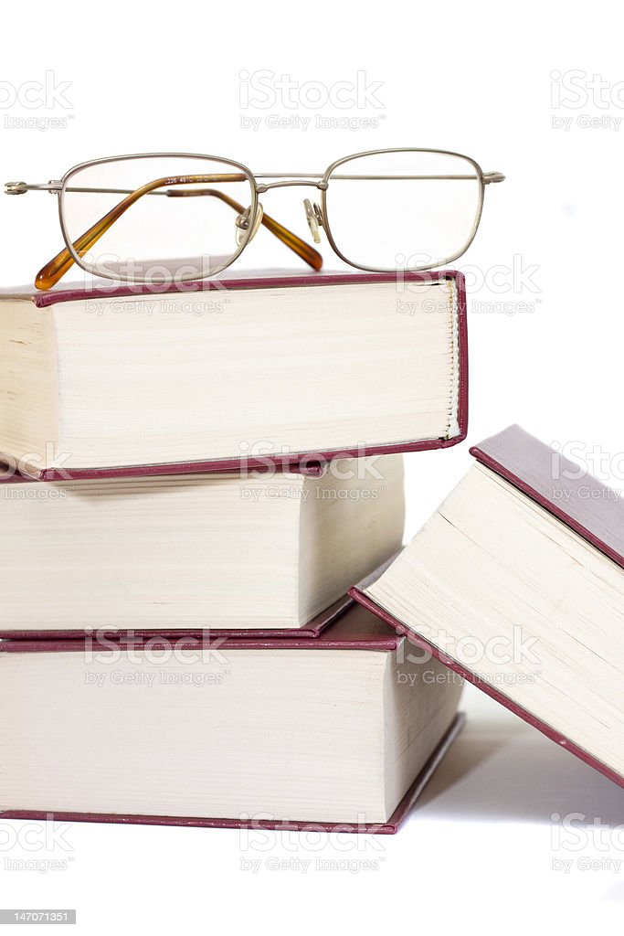 pile of books with glasses over it royalty-free stock photo