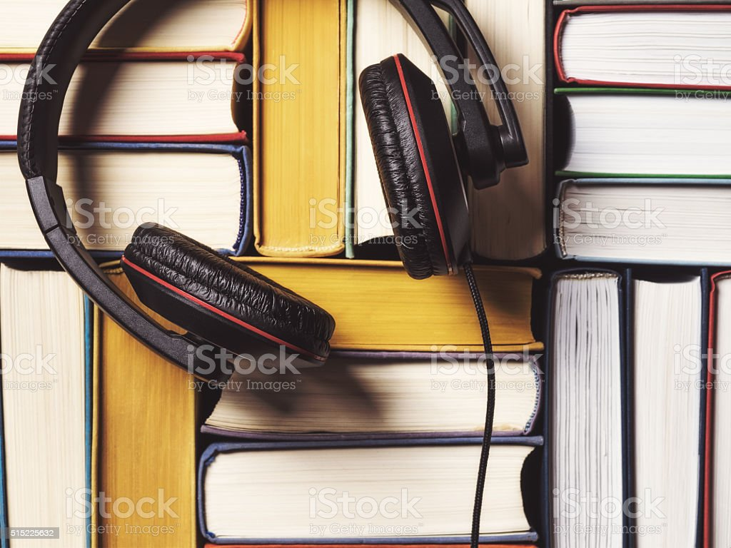 Pile of books with headphones stock photo