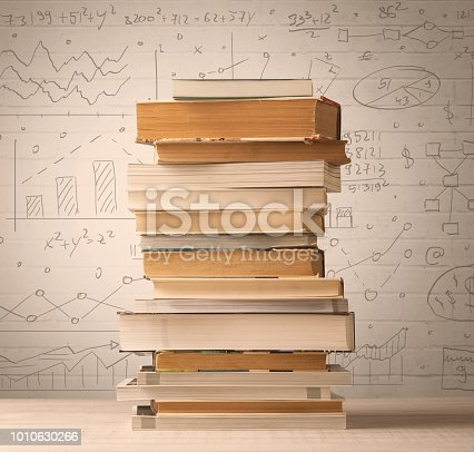 istock A pile of books with math formulas written in doodle style 1010630266