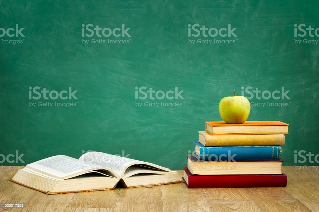 pile of books with one book open stock photo
