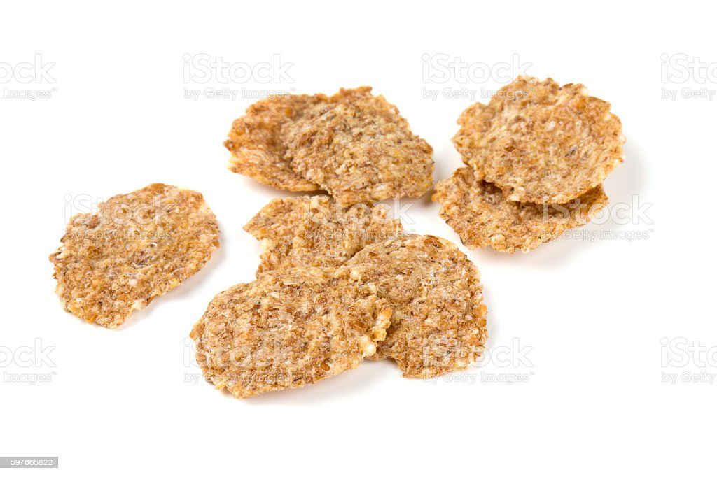 pile of bran flakes isolated on white stock photo