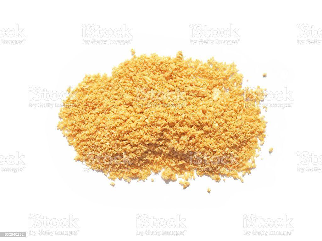 Pile of bread crumbs isolated on white. Top view stock photo