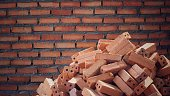 pile of bricks prepared for brickwork or masonry building and brick wall background in construction site