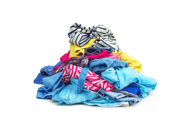 a pile of bright clothes isolated on white background - heap stock pictures, royalty-free photos & images