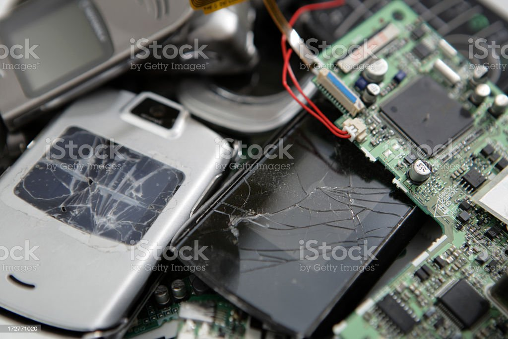 Pile of broken electronic gadgets a pile of junk electronic items phones , circuit boards etc Analog Stock Photo