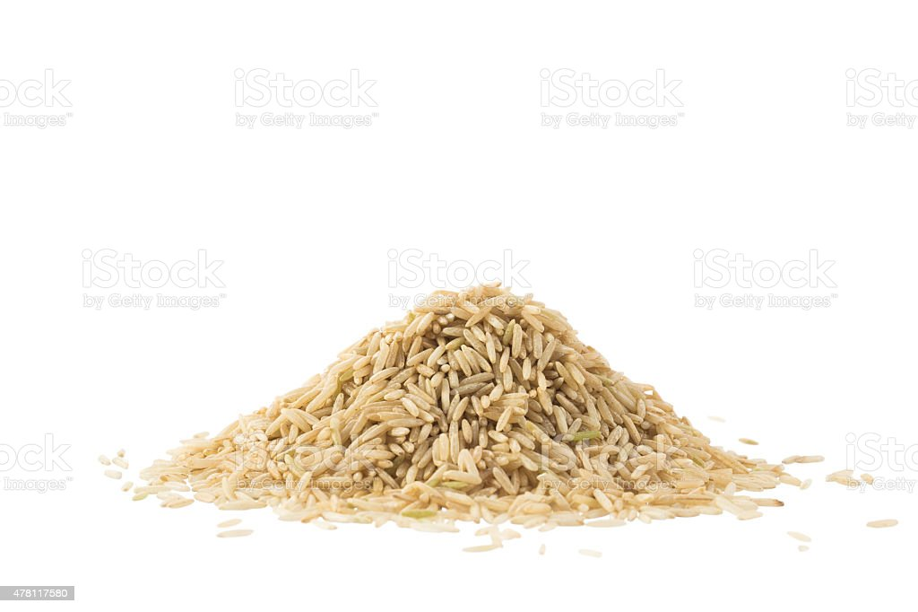 Pile of brown basmati rice isolated on white stock photo